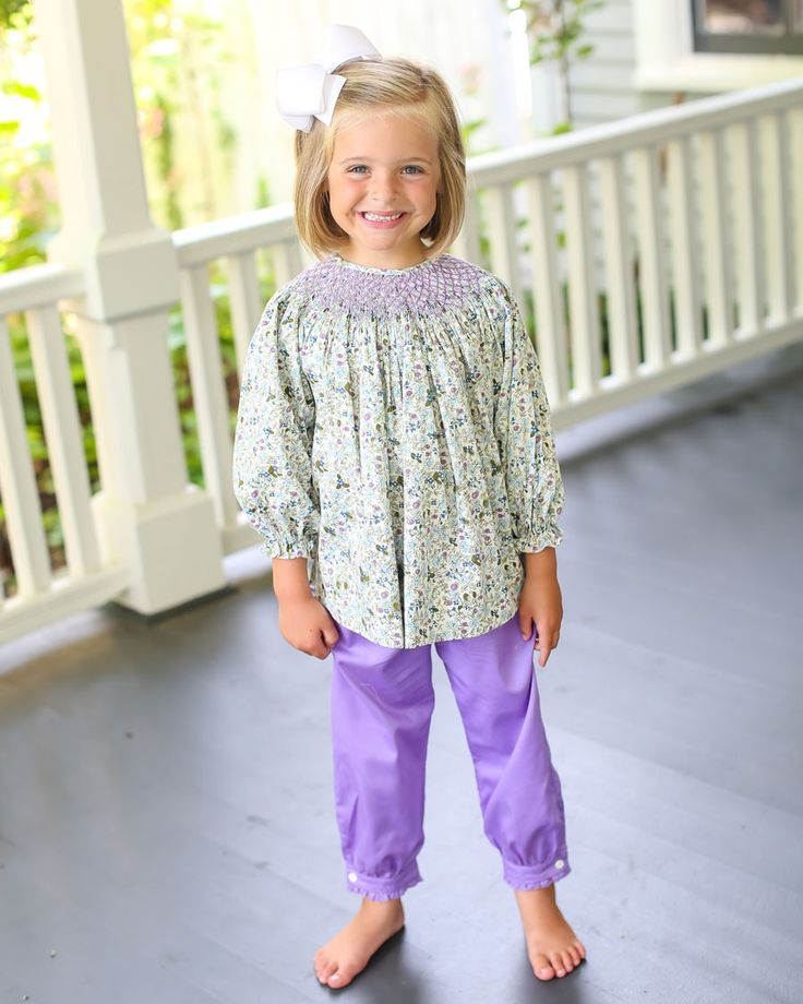 Sarah+Floral+Smocked+Pants+Set+-+Smocked+floral+top+with+purple+smocked+detail.++Purple+pants+with+a+cuff,+button+and+ruffle+complete+this+set.