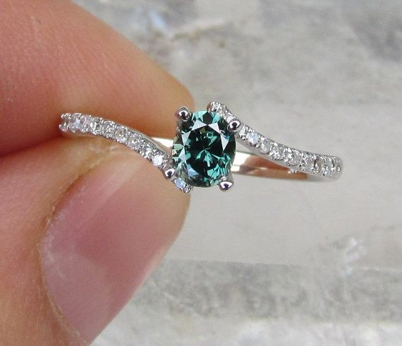 Blue Diamond Engagement Ring by PristineJewelry on Etsy love the colour