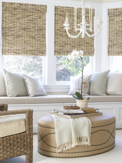Beautiful Window Seat, ottoman, bamboo shades, rattan chairs, etc.