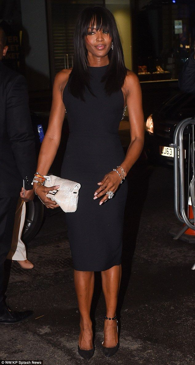 Model behaviour: Supermodel Naomi Campbell showed off her statuesque figure in a fitted black dress as she arrived for the bash