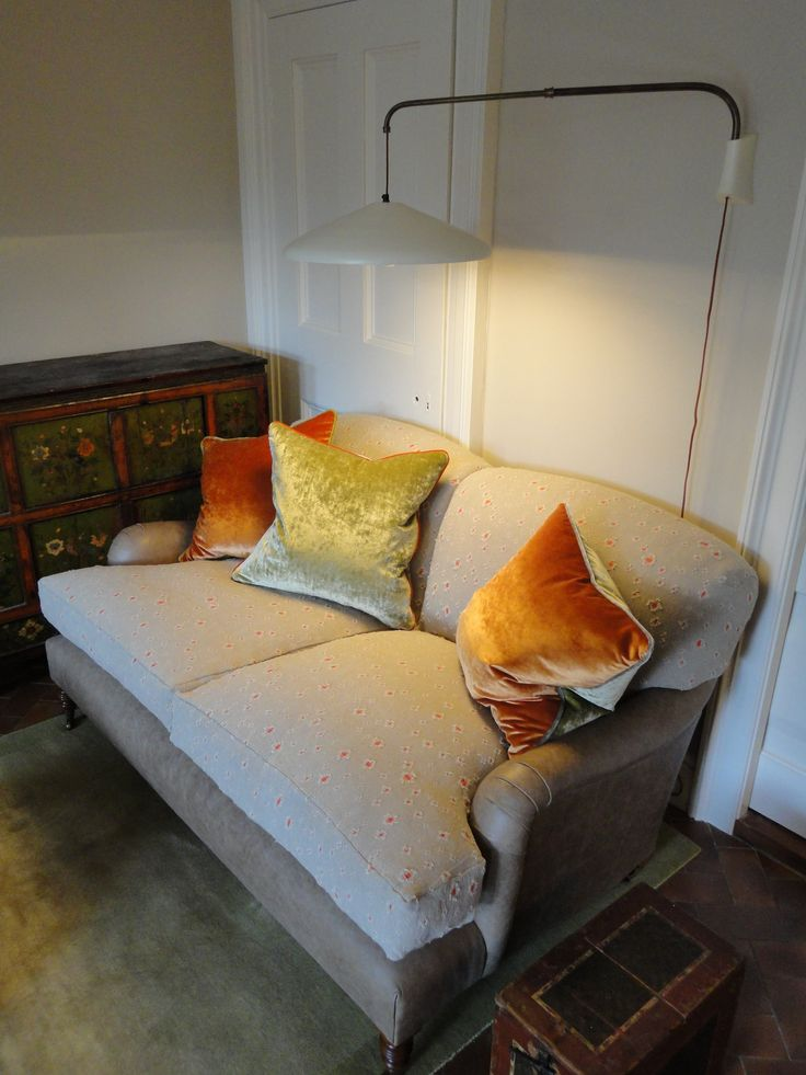 Howard style sofa, weighted wall lamp.