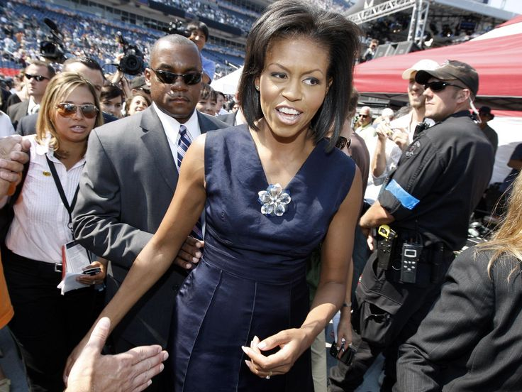 Michelle Obama, wife of Democratic presidential candidate, Sen. Barack Obama, D-Ill., walked through a crowd at Invesco Field, site of the final day of the Democratic National Convention in Denver on Thursday, Aug. 28, 2008.