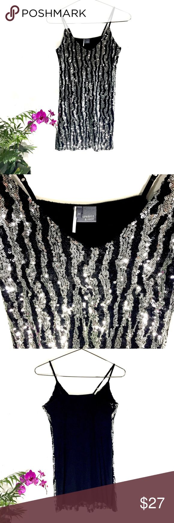 🌵Urban Outfitters sequin black & silver Tunic This sparkle and fade really sparkles!  Size Medium (wore it once to a Spurs Game).  EUC Urban Outfitters Tops Tunics