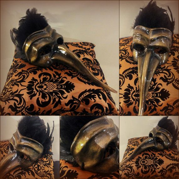 Black and gold Venetian mask, inspired by the traditional Plague Doctor mask. Totally hand-painted, the mask is beautifully decorated with black