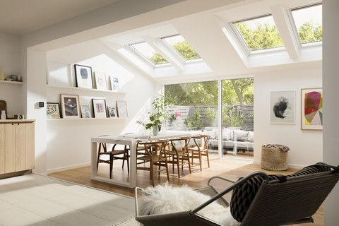 These white painted VELUX roof windows really add some light to the room