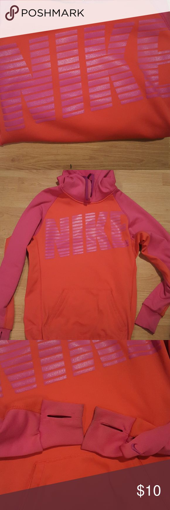 Nike hoodie Orange and pink, thermafit, size small, has thumbholes, a little wear on sleeves (pictured)-would come out with stain remover/bleach, otherwise excellent condition Nike Tops Sweatshirts & Hoodies