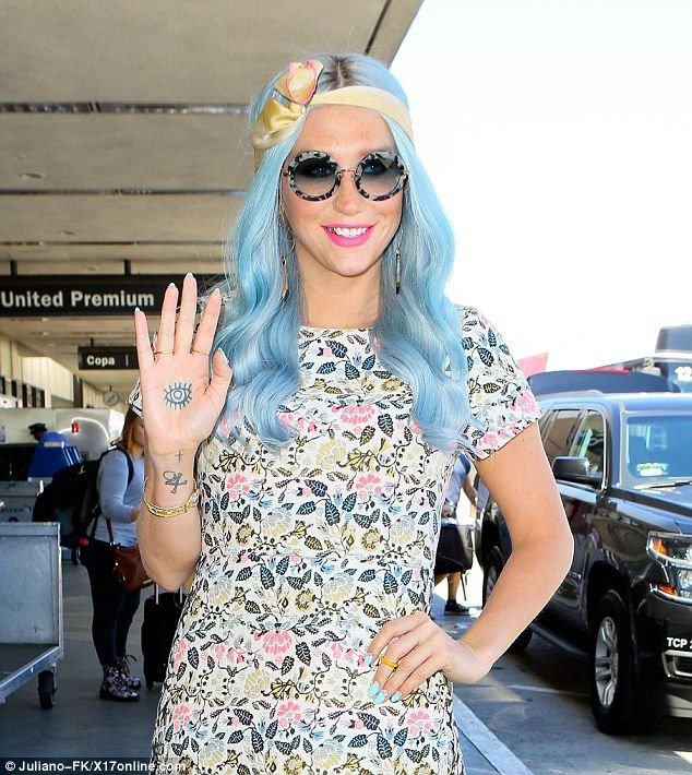 kesha flashes her hand tattoo and flaunts new hair color at la airport