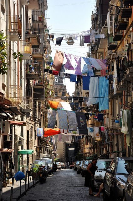 Napels, Italy:  Cramped streets, laundry hanging from windows, mopeds, and Italian women yelling from their windows to their children in the streets!  I love it!! Must move here....