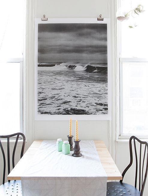 easily hang large wall art, an engineering print with binder clips (via Design Sponge)