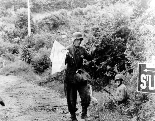 """historywars: """"German soldier surrenders to US troops in St.-Lo """" Normandy, 1944 - pin by Paolo Marzioli"""