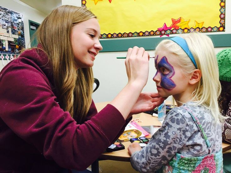 Painting faces at community event
