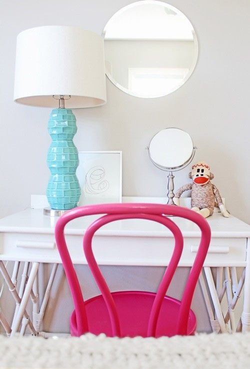 teal table lamp + simple styling + pink bentwood chair + frameless mirror