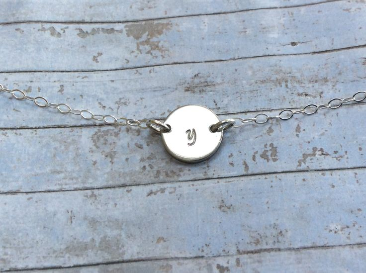 "One initial stamped pewter disc 1/2"" on a silver chain connected directly to chain €20. .. simple understated personal jewelry!"