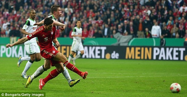 Mario Gomez scoring the second of his hat-trick for FC Bayern Munich against Wolfsburg in the 2013 DFB-Pokal semi-final at the 83 minute mark (Bongarts/Getty Images in UK Daily Mail)