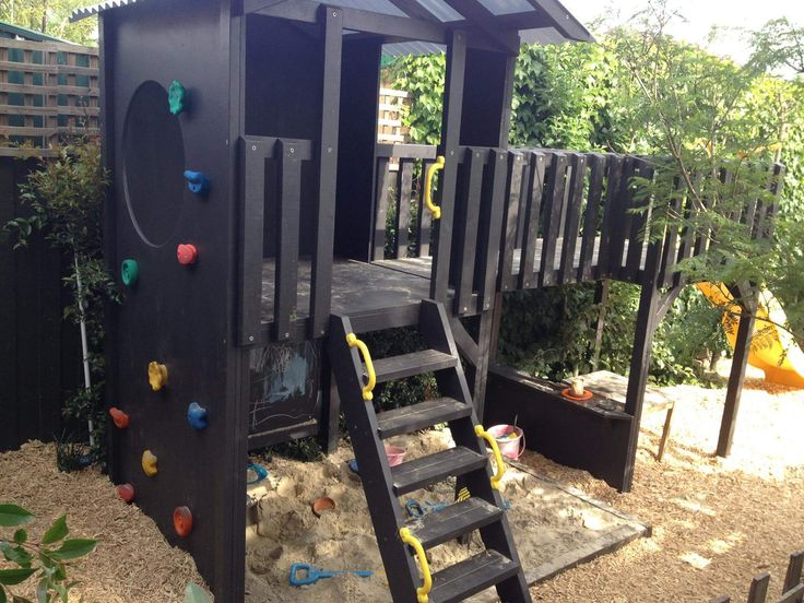 Outside play in this fun fort with bridge & rockwall. #play #cubbies #cubbyhouse