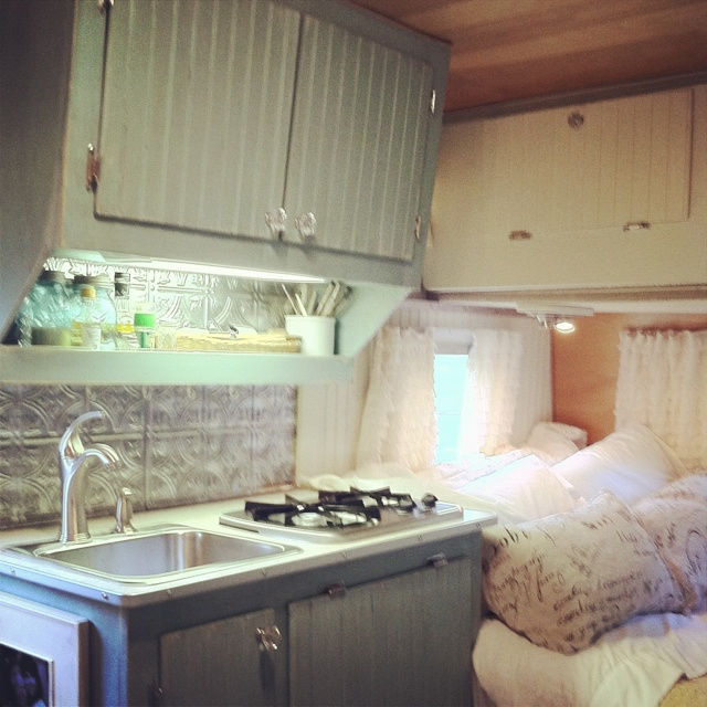 Camper Interior Tin Backsplash Scotty Hilander Beadboard Cabinetry Under Cabinet Lighting Vintage Faucet