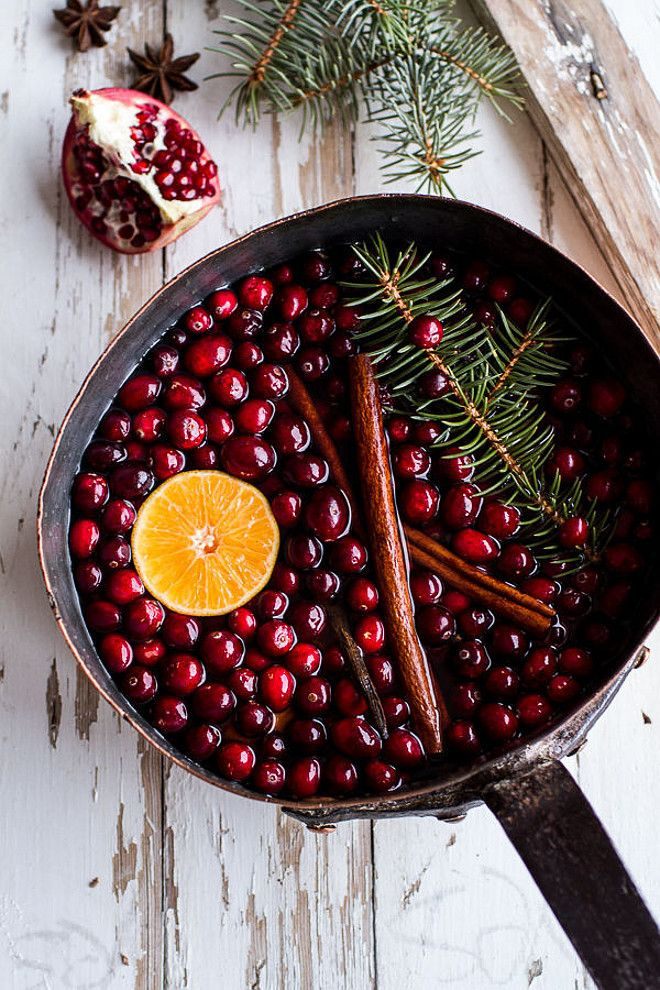 Christmas. How to make your home smell like Christmas. Simmering potpourri pot: Mix any combination of scents that make you think of the holiday (cranberries, pine, cinnamon, nutmeg...and the list goes on) and simmer in a pot of water for as long as you like to make your home smell like the yummiest one on the block. Via Domino Magazine. Photography by HALF BAKED HARVEST.