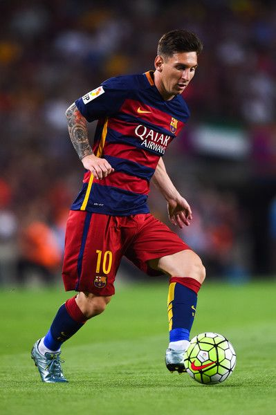 Lionel Messi of FC Barcelona runs with the ball during the Joan Gamper trophy match at Camp Nou on August 5, 2015 in Barcelona, Catalonia.