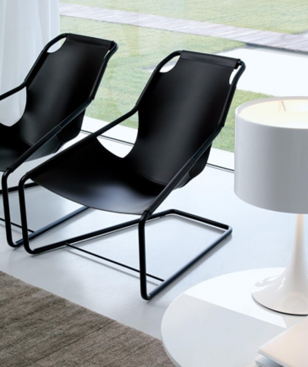 "Lina Chair is a cantilevered chair with black expoxy finish metal and black or brown leather.  The seat and back are slung in leather and holds your body at an incredibly comfortable angle.  Optional head cushion available.  28"" w x 34.5"" d x 33"" h  Manufactured in Italy by JESSE  Available at POMP HOME in Culver City, CA  www.pomphome.com"