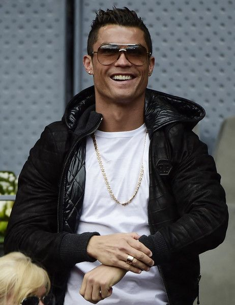 Real Madrid's Portuguese forward Cristiano Ronaldo smiles as he attends the Madrid Open tournament at the Caja Magica (Magic Box) sports complex between Spanish tennis player Rafael Nadal and Portuguese tennis player Joao Sousa in Madrid on May 6, 2016..Rafael Nadal will face defending champion Andy Murray in the Madrid Masters semi-finals after extending his perfect start to the European clay-court season to 13 matches with a 6-0, 4-6, 6-3 win over Joao Sousa today... / AFP / JAVIER SORIANO