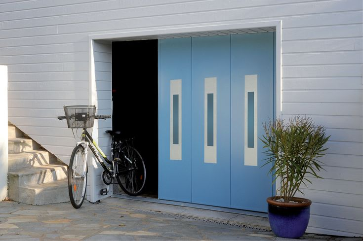 Nouvelle porte de garage sectionnelle latérale Maestro Evolution de France Fermetures #portedegarage #maison #securite #confort #design #garage