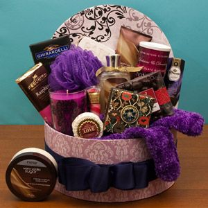 Spa Mama: fill a hatbox with little luxuries, moisturizer, bubble bath, scented candles, scrubbie, hot cocoa, chocolate-covered cherries, lip balm, soaps, & fluffy socks. Create a basket that looks full by carefully placing items. First use filler ie shredded paper, styrofoam pellets & cover w/ tissue paper as a base. Position gifts by height & size so they can be seen. Fill in w/ tissue & small items. Use a little tape on the back to keep the goodies in place. Don't be stingy with the…