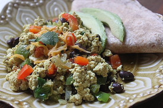 Versatile, quick, and perfect for breakfast, lunch, or dinner, a basic tofu scramble is a great go-to meal. This vegan tofu scramble brings the Southwest to your table, fast.  Calories: 135 Photo: Jaime Young