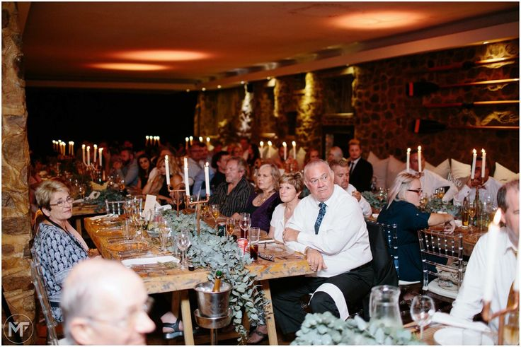 Wedding reception with wooden tables