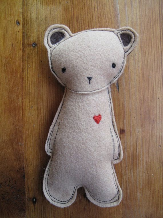 Small stuffed bear with heart