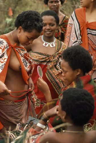 Africa   Young Swazi women put on their best attire for the wedding ceremony. Nongoma, Kwazulu-Natal, South Africa.   ©Volkmar K Wentzel