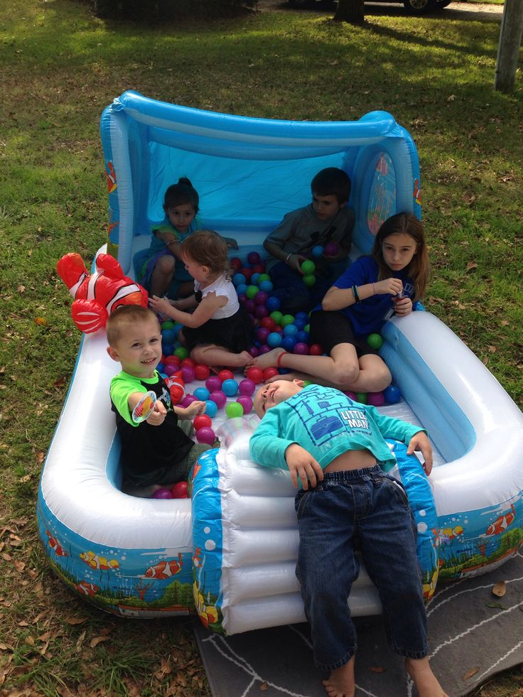 Instead of buying a pre made ball pit kit, make your own. You can buy bulk plastic balls online or at Wal-mart and put them in an inflatable pool and you'll have instant fun.
