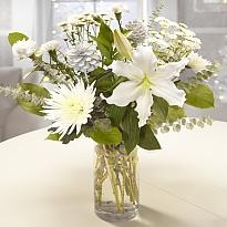 Cinderella - The star of this Cinderella bouquet is a crisp white Lily, entwined with white Bloom Chrysanthemums, soft Spray Carnations and white Pine Cones, beautifully wrapped with a bow, in true Cinderella style.