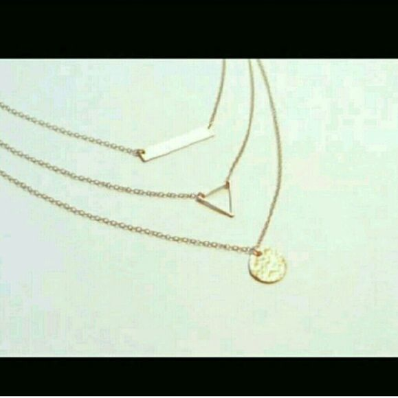 Delicate Triangle Balace necklace 18 kt plt gold Delicate balance triangle necklace with card in gold tone. 15-18 inces adjustable Brand new No trades Price reduced and firm. BUNDLE FOR DISCOUNT. Sherri Souza Jewelry Jewelry Necklaces