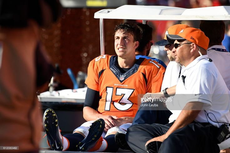 Denver Broncos quarterback Trevor Siemian (13) is carted off the field to the locker room with two minutes in the half against the Tampa Bay Buccaneers October 2, 2016 at Raymond James Stadium. Siemian was injured on a sack play.