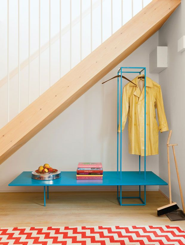 organized entry bench/coat rack. love the simply designed broom and dustpan too.