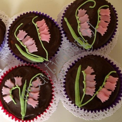 cupcakes with a small ganache and organic marzipan layer and marzipan spring flowers.