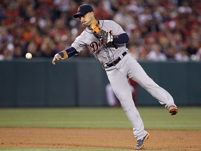 Detroit Tigers shortstop Jose Iglesias throws out Los