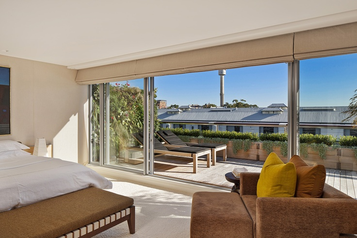 Balcony Garden with sun loungers and Greenwall.  Walsh Bay, NSW Australia   Anthony Wyer + Associates   www.anthonywyer.com