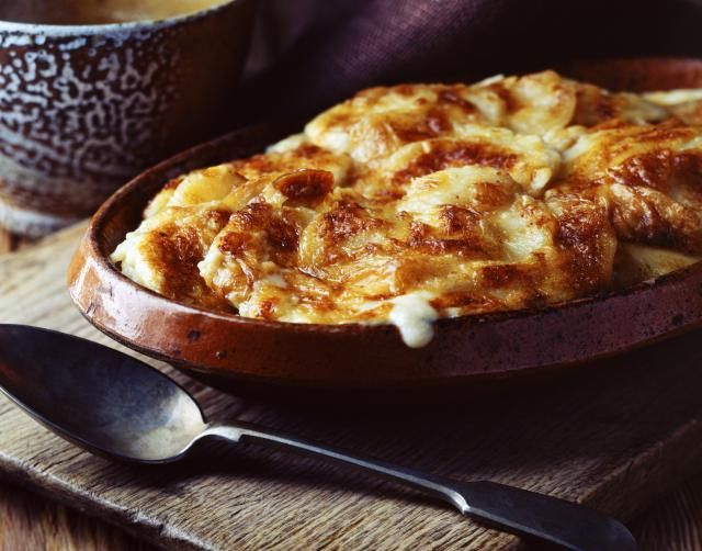 Ultimate comfort food comes in the shape of a Classic French Gratin Dauphinois of soft, melting potatoes soaked in garlicky cream and easy to make.