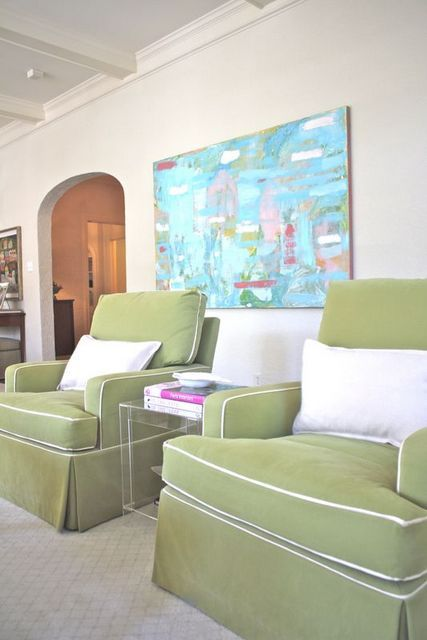 Cynthia Collins Interiors. Club chairs with contrasting piping. Lucite side table.-via Interior Canvas