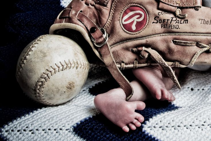 Pure Photography & Design. Baby lying under a baseball glove with feet ...