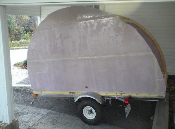 Using foam and fiberglass to make a DIY pull behind camper weatherproof - clever