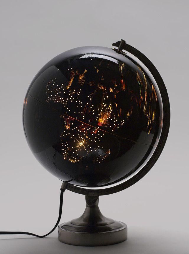 Fred Wilson (born 1954, the Bronx) | A Thousand Points, 2009 | illuminated plastic globe, die cast steel and enamel paint, 43.2 cm x 30.5 cm x 29.2 cm