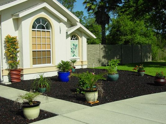 Landscape Design With Black Mulch : Natural black rubber mulch used in hardscape landscape design http