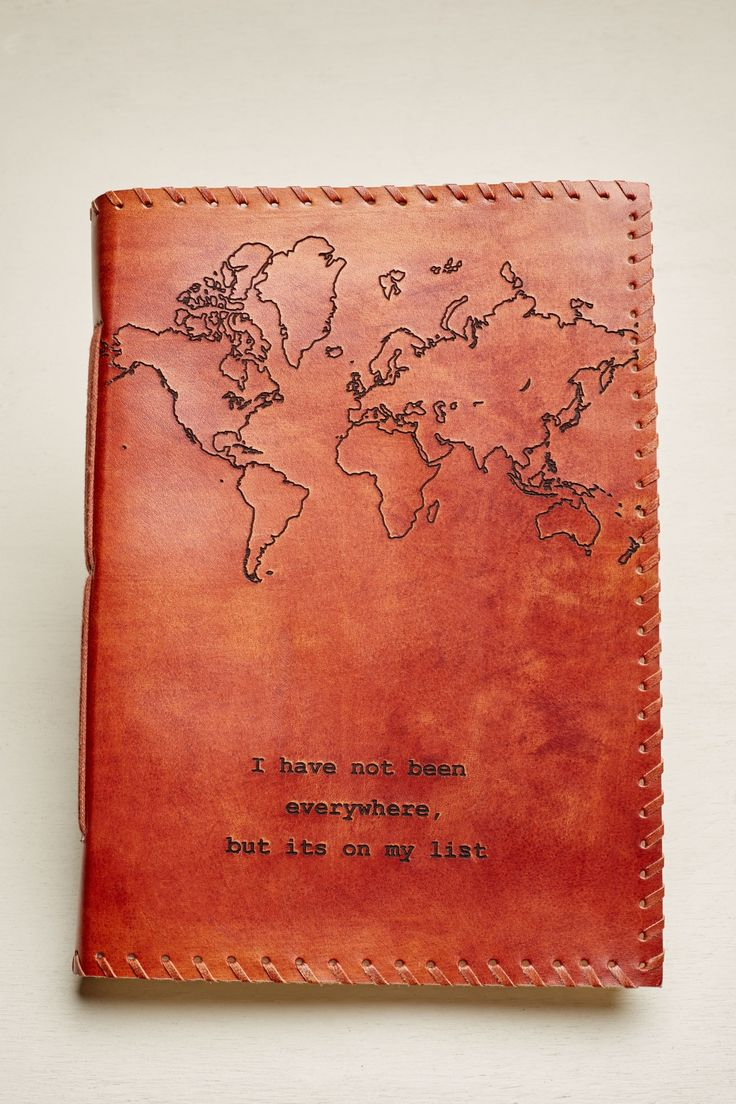 Chronicle your dreams, thoughts, or adventurous travels in this leather journal from India! This large journal features a map design and travel quote on the cover.