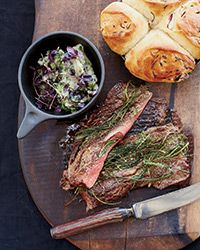 """Griddled Gaucho Steak with Bread-and-Basil Salad - To turn beef tenderloin into a quick-cooking cut, grilling master Francis Mallmann butterflies it first to form a quarter-inch-thick slab, tops it with chives and then sears it quickly on a hot grill. """" Recipe on Food & Wine"""