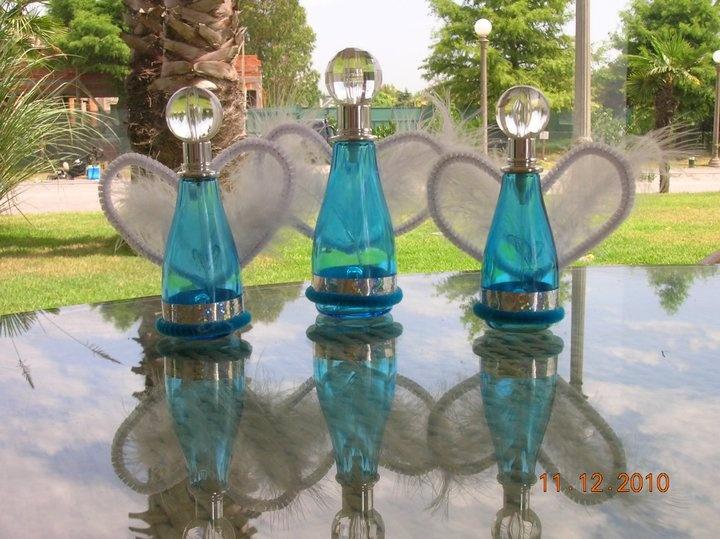 angelitos hechos con frascos de perfume. www.lacaloatamosconalambre.com