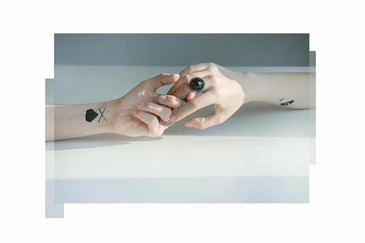 'take my hand' . Ring from RAY collection by Anna Orska. Tattoos by Maciej Kawecki.