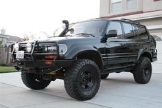 1998 Custom Lexus LX450: An Ultra Luxury Version of the Venerable Series 80 Land Cruiser. Upgraded Toyota 2UZ-FE 4.7L V8 Engine, Improved AC, Pro Performance Adaptive Suspension & Brake System and Aggressive Exterior enhancements maximize the LX450's true off road nature while preserving the luxurious comfort and status of a Lexus. Whether exploring the great unknown or raiding the local mall with friends this HARDENED LX450 will get you there and back without breaking a sweat.