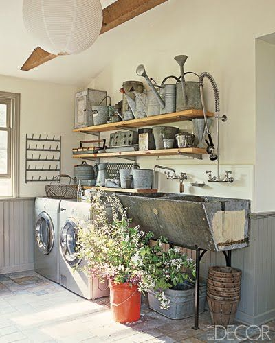 Ok, just came across this while looking for a galvanized sink for outside...this is pretty cool! I'd prefer old barn wood floors instead to bring out the rafters and shelves. Love it!